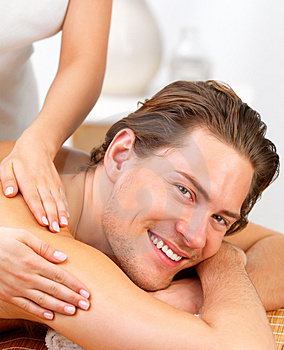happy-young-man-getting-back-massage-thumb4723756